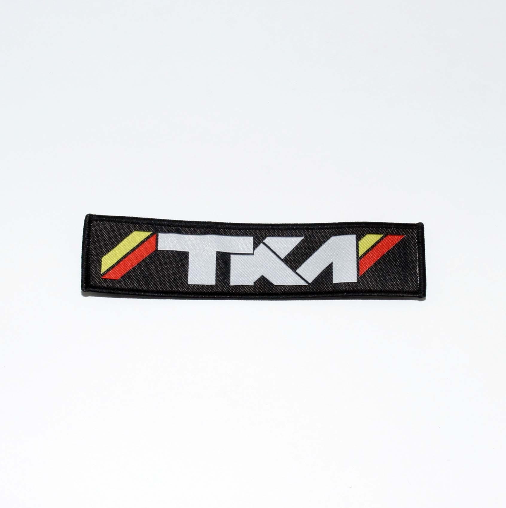 TKM RACESUIT BADGE 140 x 34